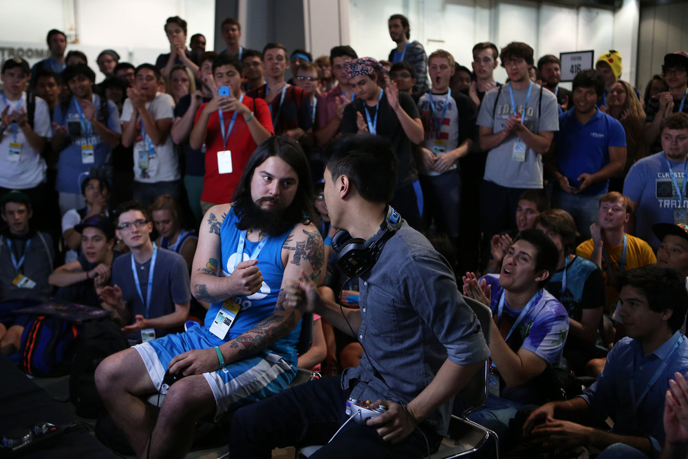 "Joseph ""MangO"" Marquez, left, faces off with Zhu before their match in Smash Bros. Melee in a classic game of rock-paper-scissors to choose the first stage. © Gail Fisher for ESPN"