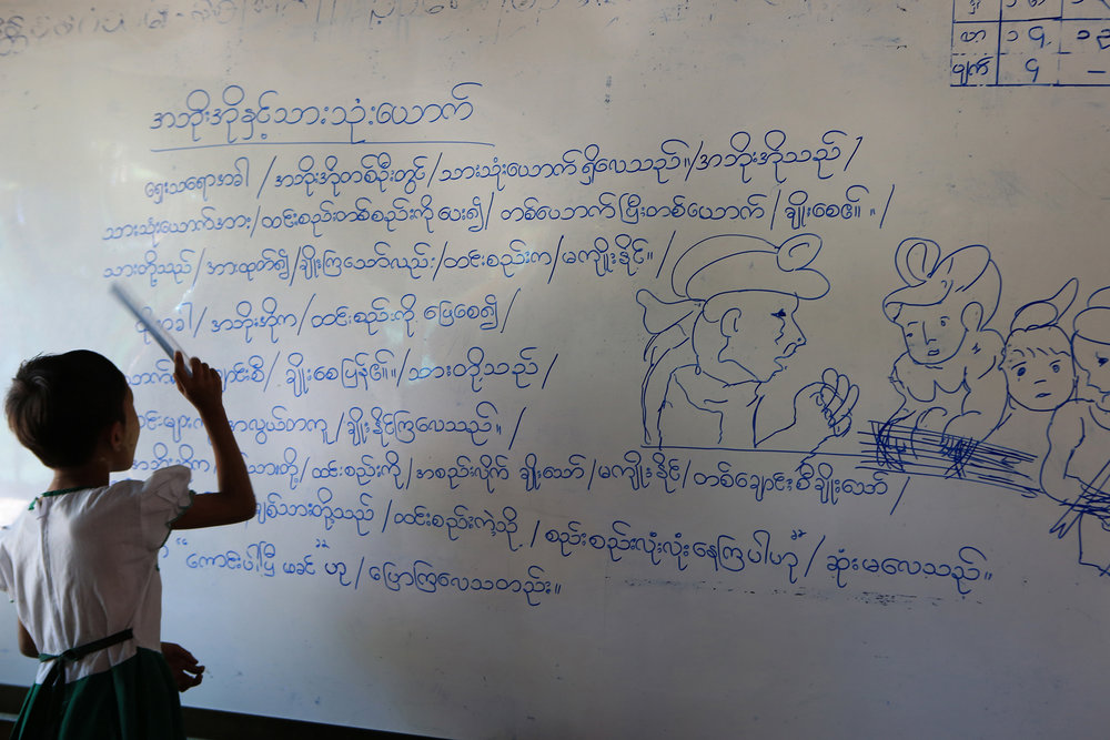 A child reviews a lesson in the Ma Soe Yein Monastery. © Gail Fisher for Los Angeles Times