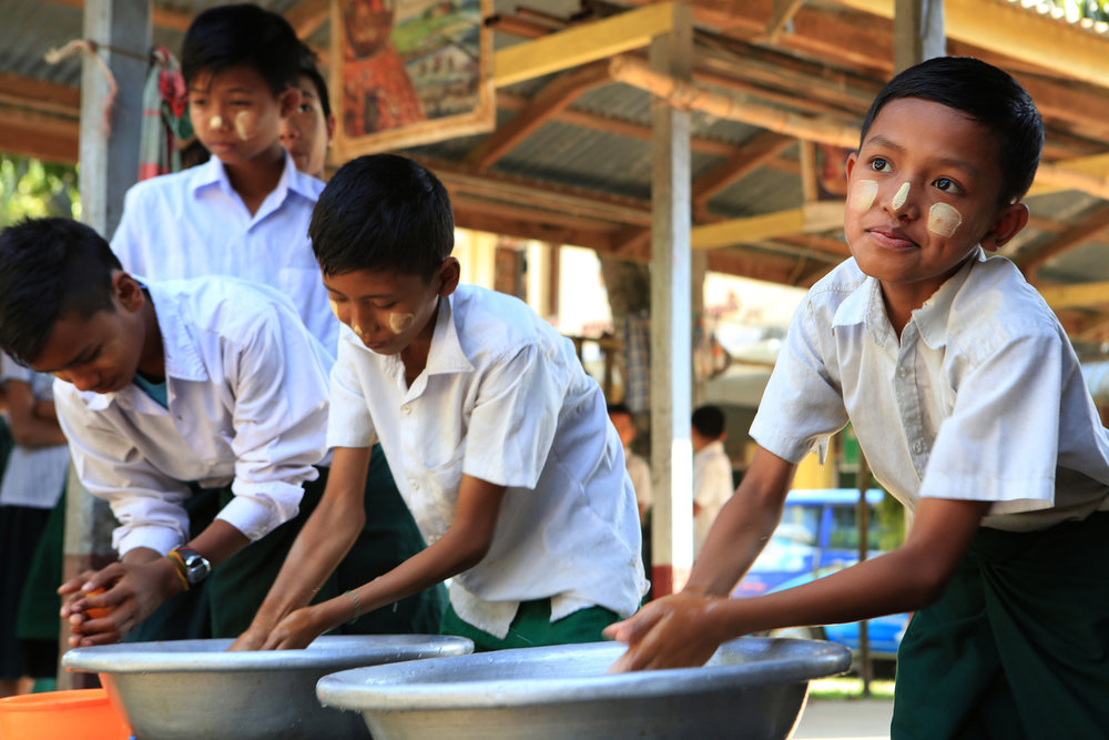 Students line up to wash hands before before a lunch of rice and vegetables. The cost of schooling and meals is subsidized by donors and the government of Myanmar. © Gail Fisher for Los Angeles Times