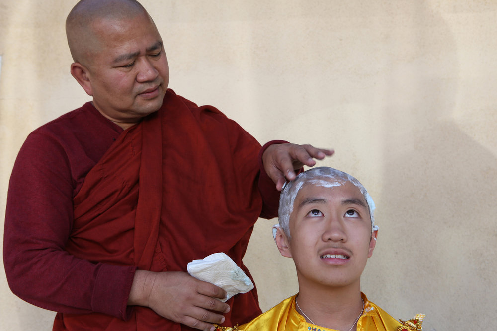 Buddhist monk Ashin Gunissara shaves the head of Filbert Win Min Aung, freshman at Arcadia High School, as the 13-year-old begins his three day stay at the Dhammajoti Meditation Center in Baldwin Park. © Gail Fisher for Los Angeles Times