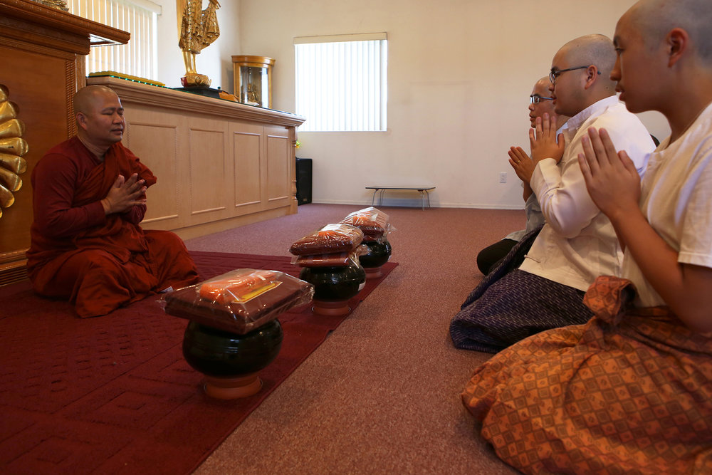 Buddhist monk Ashin Gunissara, left, works with people from all walks of life including refugees, immigrants of several ethnicities of Burma and Americans of all color. © Gail Fisher for Los Angeles Times