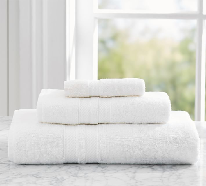 1. Crisp clean  white linens  make every bathroom feel luxurious
