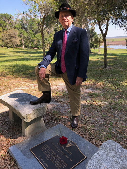 "Jack May, author of ""Breeze from the Hudson,"" at a cenotaph honoring Floyd Spencer and the men of B-2, USMA Class of 1958, at Xanadu, his home in Gainesville, Florida, in 2018."