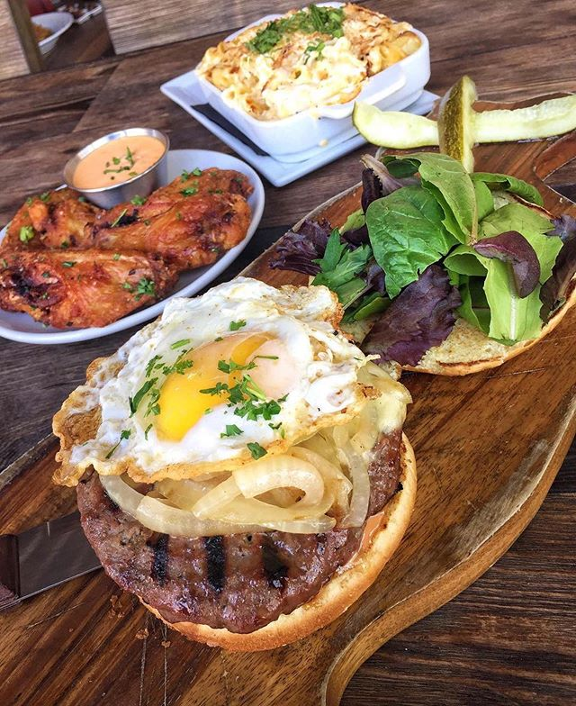 THIS WEEKEND DESERVES A TRUFFLE BURGER WITH A FRIED EGG 🍔🍳#huntingtonbeach #happyhour #KitchenRepublic ________ 📍@KITCHENREPUBLICBISTRO ________ 👇🏼TAG A BURGER LOVER