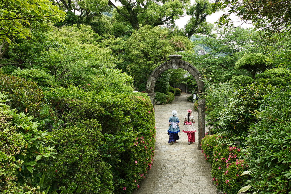 Two colonial ladies walking at Glover Garden, nice time slip.