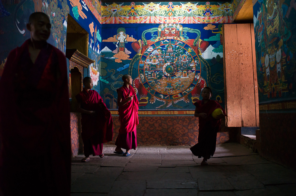 Monks rushing out for a break, Rinpung Dzong, Paro