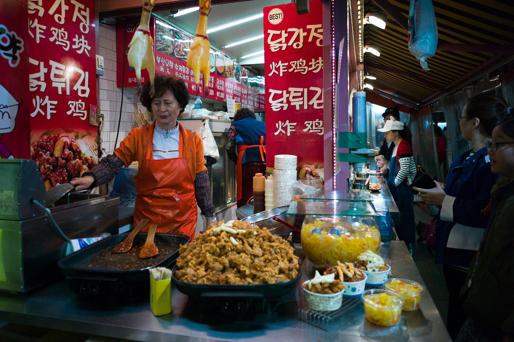 Late night snack, local street food stall around Dongdaemun market, Seoul