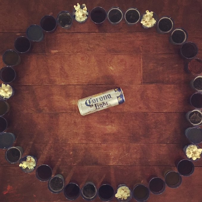 Spin the Corona, take a shot! Fill mini shot glasses with different types of booze (and pop corn as needed).