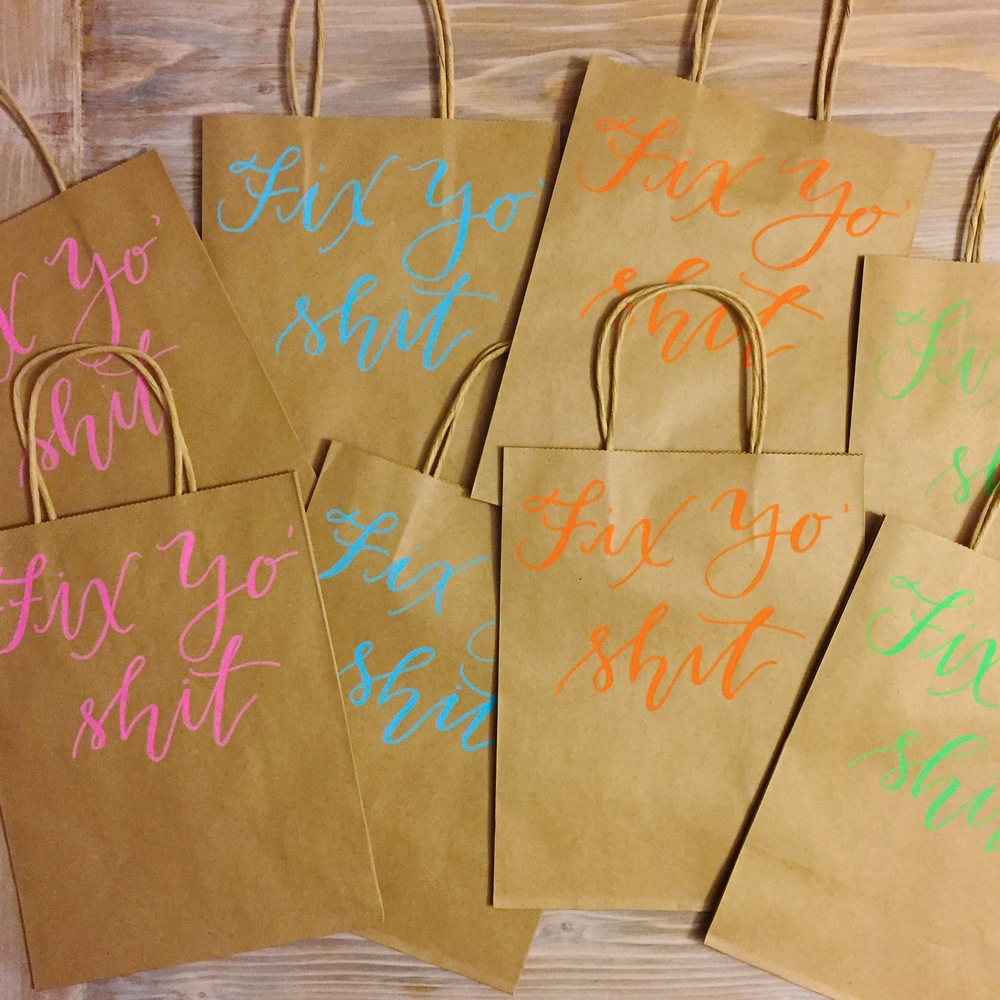 Bachelorette party gift bags on kraft paper.