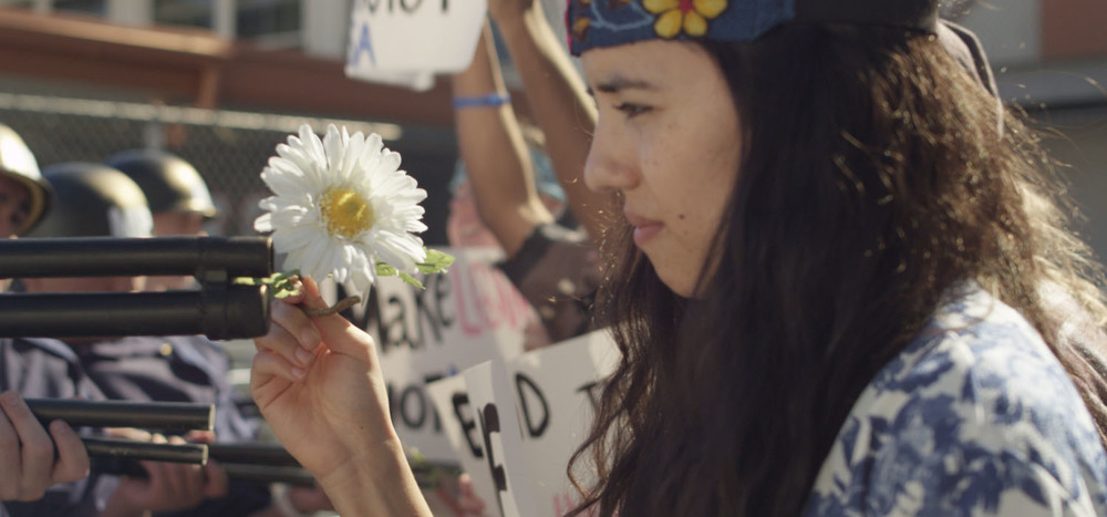 An anti-war protestor (Cynthia Callejas) tries to conquer with love in a scene from Quyên Nguyen-Le's NU'Ô'C. (Photo: Courtesy the filmmaker)