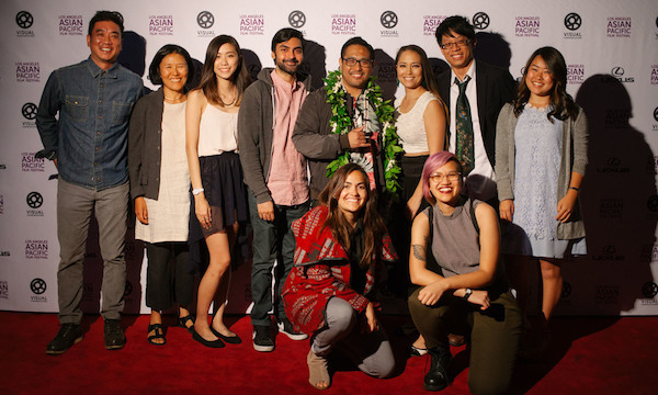 VISUAL COMMUNICATIONS' DIRECTOR OF PROGRAMS AND ARTISTS' SERVICES MILTON LIU AND AWC ADVISER ANN KANEKO WITH ARMED WITH A CAMERA 2015-2016 FELLOWS (KNEELING, L-R): TULICA SINGH AND QUYÊN NGUYEN-LE; (STANDING) KAYLA TONG, FAROUKH VIRANI, CONRAD LIHILIHI, SUMIKO BRAUN, STANLEY WONG. AT FAR RIGHT IS DIRECTOR KRISTY ISHII, OF UCLA'S VIDEO ETHNOGRAPHY WORKSHOP OF THE CENTER FOR ETHNICOMMUNICATIONS. (PHOTO: BRANDON OKUMURA)