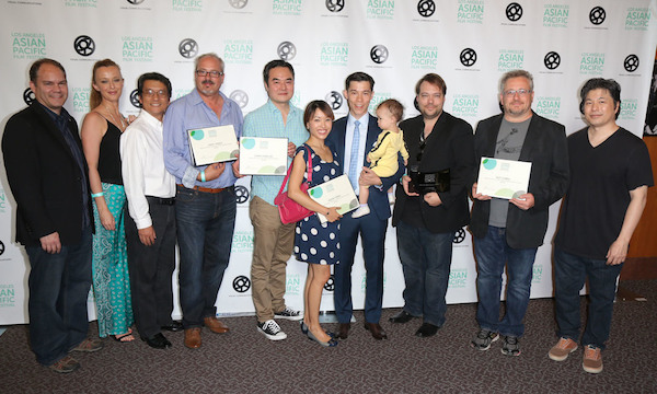 2015 LOS ANGELES ASIAN PACIFIC FILM FESTIVAL GRAND JURY PRIZE FOR BEST FEATURE GOES TO JASMINE, DIRECTED BY DAX PHELAN. HERE, THE TEAM FROM JASMINE CELEBRATES ITS FIVE AWARDS. FIFTH FROM LEFT: CHRIS CHAN LEE (WINNER, BEST EDITING); SEVENTH FROM LEFT: JASON TOBIN (WINNER, BEST ACTOR IN A DRAMA); THIRD FROM RIGHT:  DAX PHELAN (DIRECTOR); SECOND FROM RIGHT: GUY LIVNEH (WINNER, BEST CINEMATOGRAPHY). (Photo: Steven Lam)