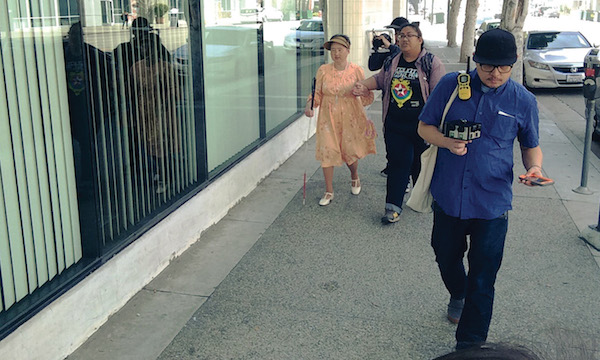ON THE STREETS OF LOS ANGELES LITTLE TOKYO: VR CAMERA IN HAND, THE AUTHOR JOEL QUIZON (RIGHT) WITH ELAINE DOLALAS AND VICKY HUANG ACCOMPANY GRACE CHIKUI ON ONE OF HER WALKS THROUGH THE NEIGHBORHOOD. (PHOTO: COURTESY THE FILMMAKER)