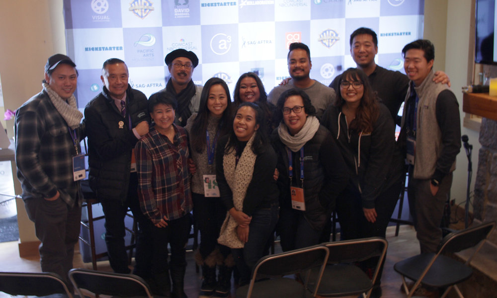 Director Jon M. Chu and Alex Wu of the Asian American Artists Foundation flank the team behind the 2018 Asian Pacific Filmmakers Experience in Park City (from left): David Magdael, Michelle Sugihara, Abraham Ferrer, Christine Minji Chang, Aubrey Magalang, Laarni Rosca Dacanay, Merissa Madgael-Lauron, Francis Cullado, Manpreet Kaur, and Marvin Yueh. (Photo: Daryn Wakasa/Visual Communications Photographic Archive)
