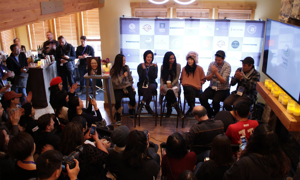 "Kollaboration's Christine Minji Chang moderates the afternoon panel, ""#AsAmCreatorRollCall Fireside Chat"" as part of the 14th Asian Pacific Filmmakers Experience in Park City at Kickstarter Lodge (from left): Chang, Tiffanie Hsu, Gingger Shankar, Vivian Bang, Andrew Ahn, and John M. Chu. (Photo: Abraham Ferrer/Visual Communications Photographic Archive)"