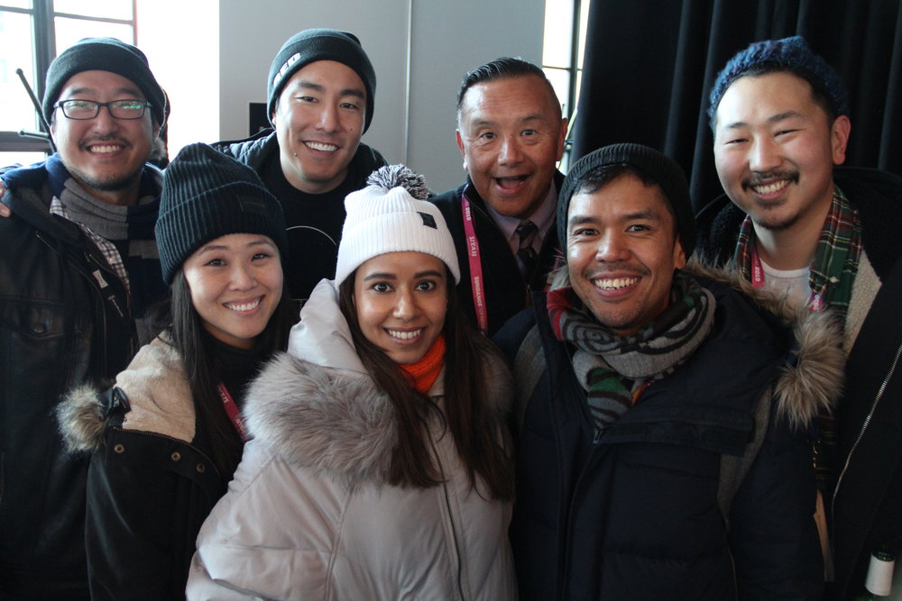At the RYOT & VICE Studios Lounge, a sea of happy people greet visitors to the Asian Pacific Filmmakers Experience in Park City's kick-off meet-and-greet (from left): Producer Andrew Lee (SEADRIFT), Minji Chang, Kenji Tsukamoto, Sujata Day, David Magdael, Dino-Ray Ramos, and Andrew Ahn. (Photo: Abraham Ferrer/Visual Communications Photographic Archive)