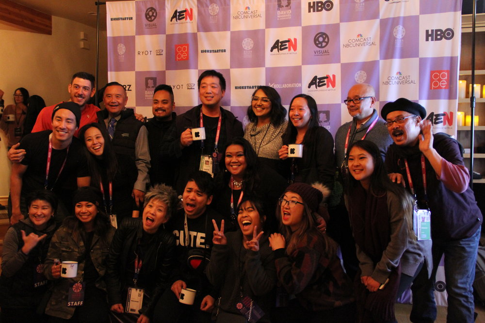 The #APAParkCity crew take one last curtain call before departing the Kickstarter Lodge (from left): Michelle Sugihara, Kenji Tsukamoto, Netflix' Alex Hudson, Rachelle Samson, Minji Chang, David Magdael, Susna Jin Davis, Francis Cullado, Kevyn Fong, Marvin Yueh, Laarni Rosca Dacanay, Aubrey Magalang, Manpreet Kaur, Jess Ju, Lindy Leong, Bennie Magdael, Mimi Lu, and Abraham Ferrer. (Photo: Abraham Ferrer/Visual Communications Photographic Archive)