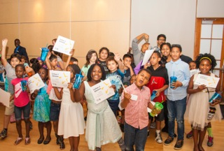 Students receive recognition alongside their families at the 2016 Academic Achievement Banquet.