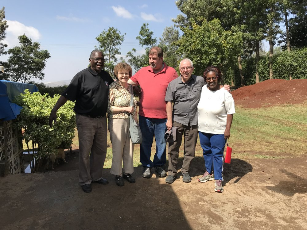 Side by Side representatives meet with founders of Tania Centre, Joseph and Jennifer Kigunda.