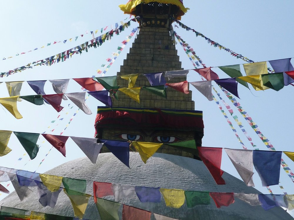 Prayer flags surround a temple in Nepal