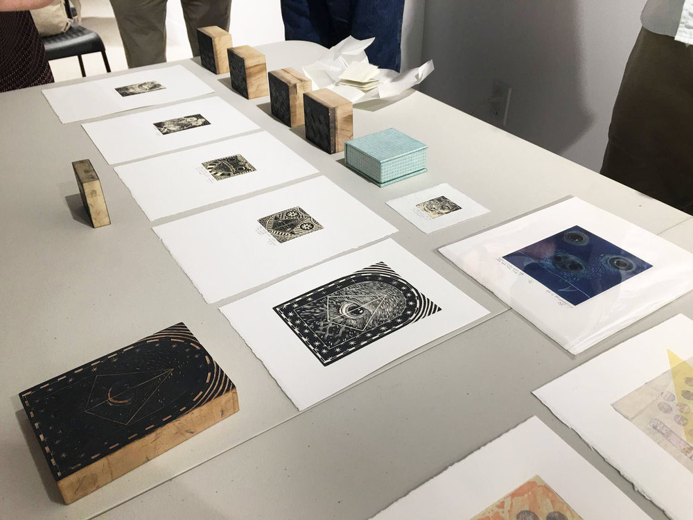 A closeup of some of Eric's wood engravings and lithography