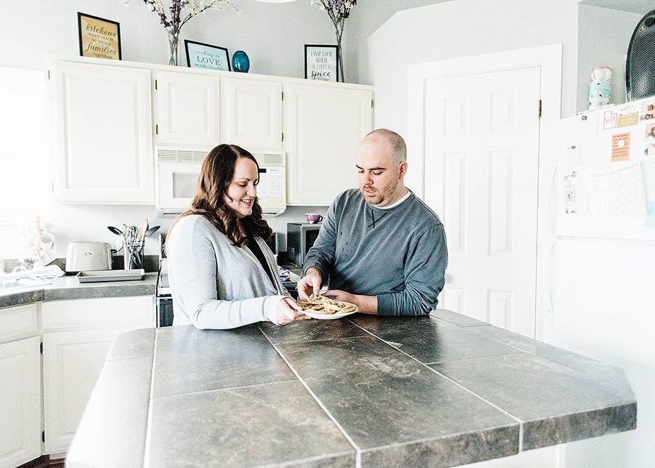 Couple enjoying fresh baked cookies together
