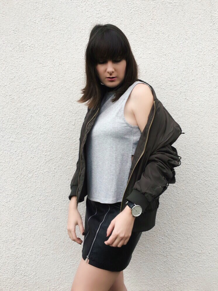 Wearing: NA-KD.com bomber jacket, top, leather skirt & choker / New Era hat / Marc Bale watch