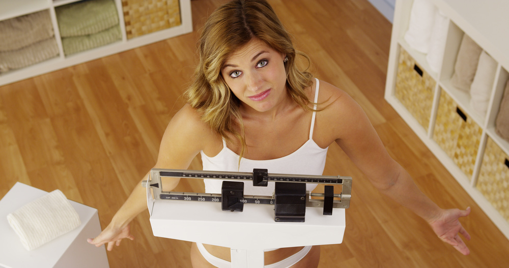 women on weight scale