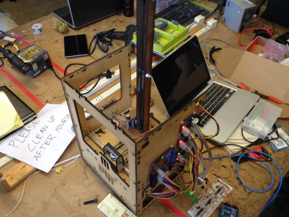 This image is of our first prototype. We stripped down an old 3D printer and used two of its axes upon which we mounted a vertical axis that I built. This prototype allowed for a LED to be moved around in 3D space.
