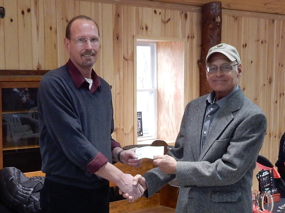 Board Member Jim Murphy presenting The Great Swamp Conservancy with a donation.