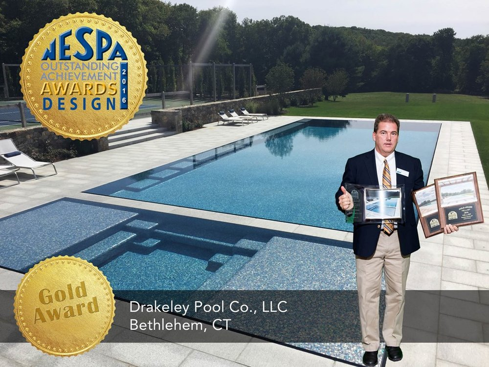 "Bill Drakeley accepts THREE Gold Awards for this glass tiled, knife-edge beauty, fondly referred to as the ""jewel of the property"" by our client."