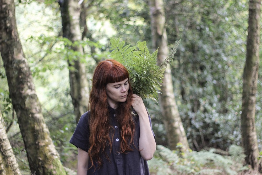 Girl with Ferns in Woods