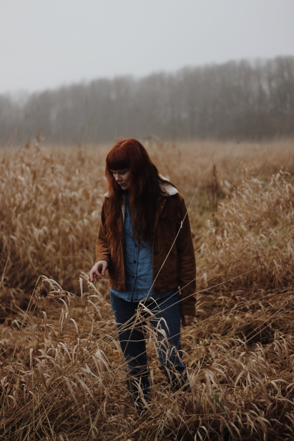 Girl in field in mist
