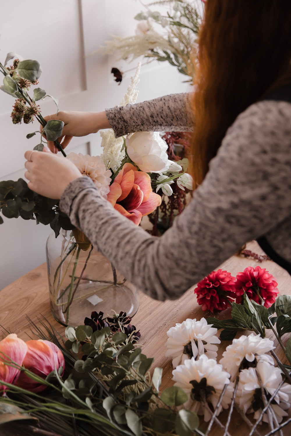 Flower arranging with faux flowers