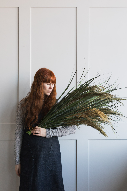 Holding pampas grass