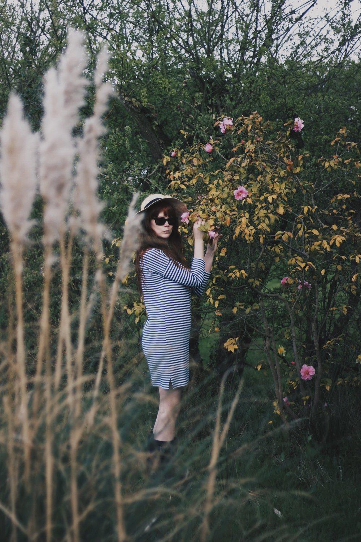 Girl in garden wearing hat