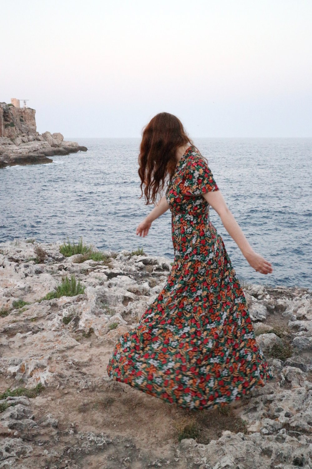 Girl dancing on cliffs