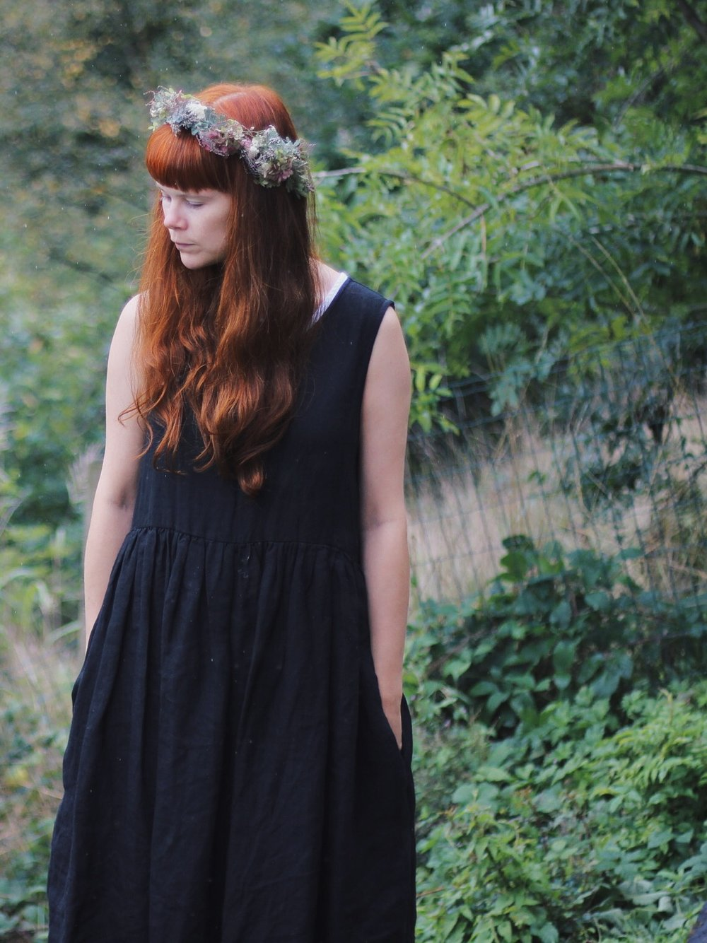 Girl wearing black linen dress