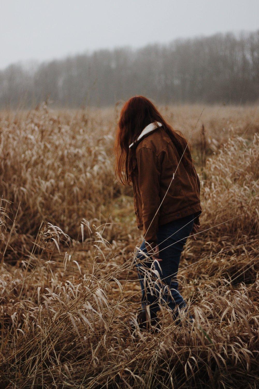Girl in meadow in winter