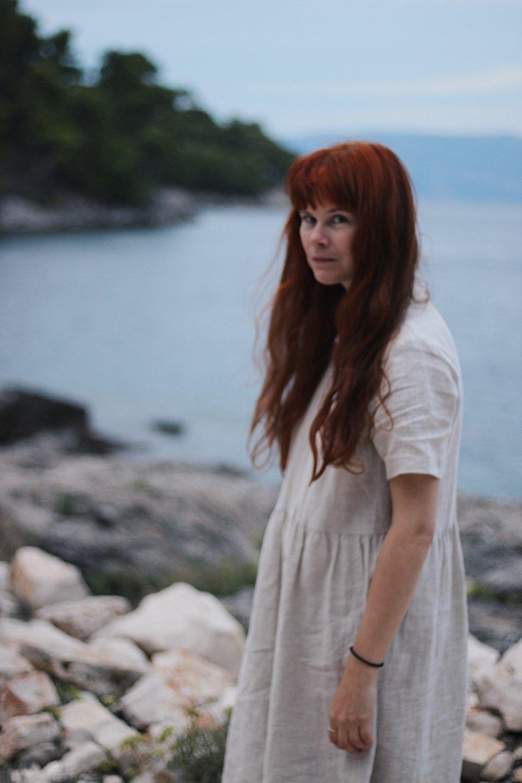 Girl in linen dress on beach