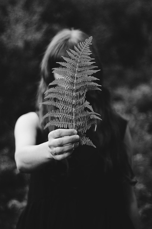 Girl Holding Fern, Nature Portrait