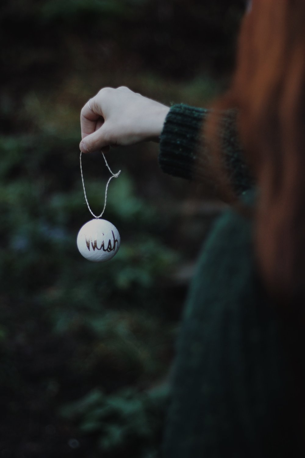Girl holding bauble, Redhead Girl, Winter, Christmas, Green Jumper, Christmas Bauble