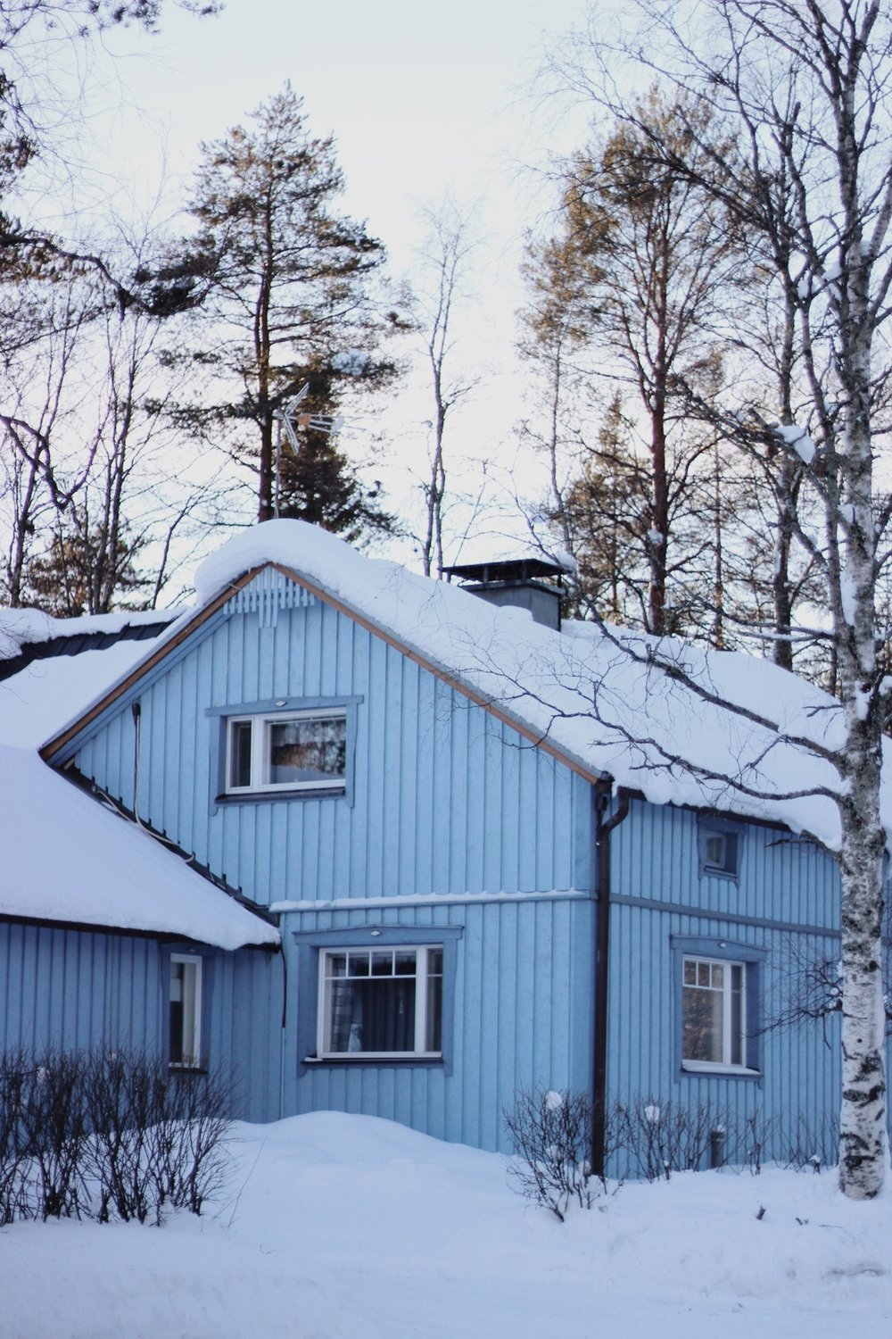 Blue Wooden A-Frame House in Finnish Lapland