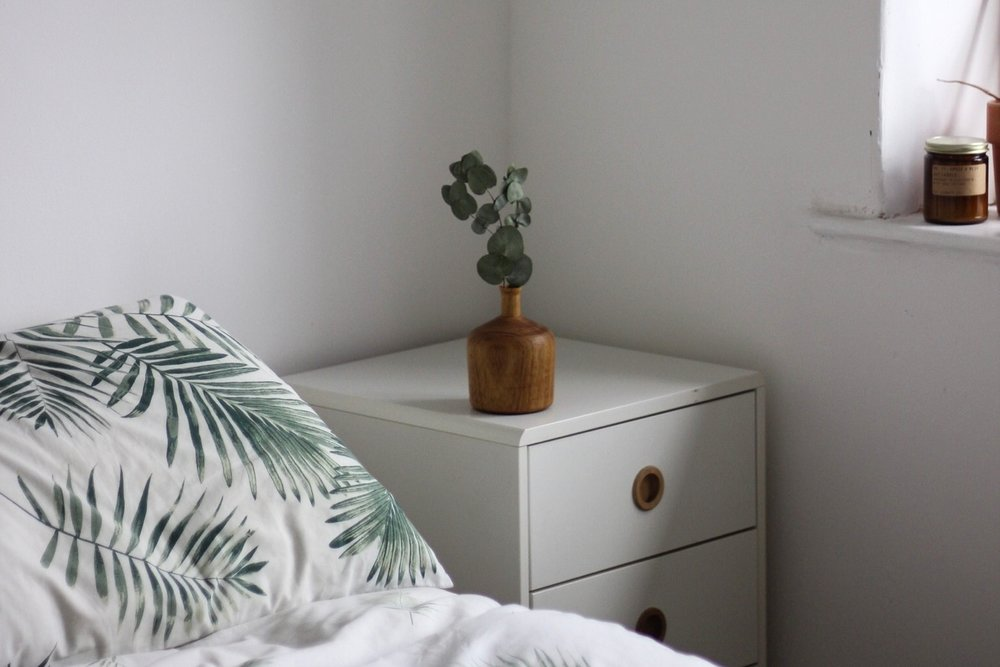 Slow and simple bedroom, white walls, plants