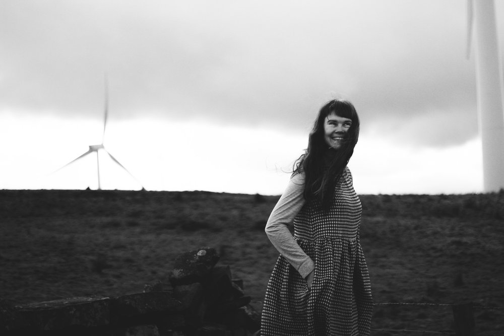 Black and White, Girl on moor wearing gingham dress