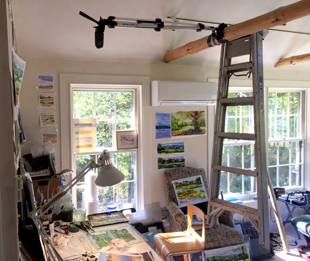 The time-lapse setup in my studio space in Sheffield. The time-lapse camera is on the tripod, but duct tape wasn't enough to keep it level over my drawing table. Solution: counterbalance by ladder!