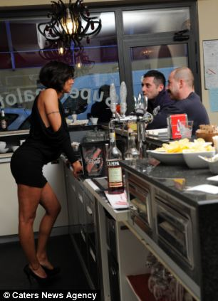 Cafe owner Laura Maggi attracts a lot of male attention.