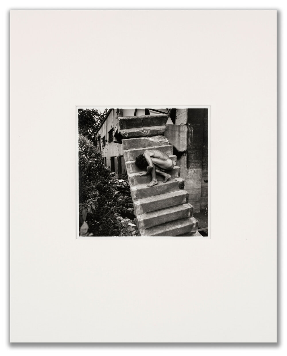 Arthur Tress, (American b.1940), Nude on the Stairs, 1970.