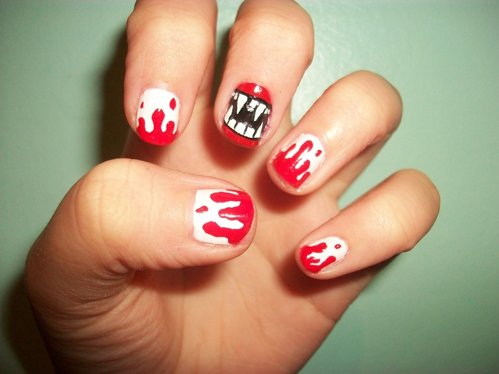 Halloween Sassy    Kill the game with this blood chilling mani.    via abbbbbie     Have you joined the Sassy Nation yet? Keep up with the latest…     http://sassynation.tumblr.com