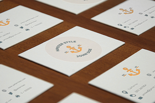 Business cards on a table with various designs
